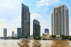 View of riverside buildings along the Chao Phraya river Stock Images