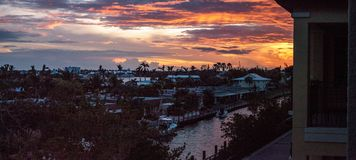 View of a riverway at sunset with purple and pink in the sky. In Naples, Florida Royalty Free Stock Photos