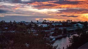 View of a riverway at sunset with purple and pink in the sky. In Naples, Florida Stock Images