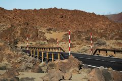 Road across volcanic fields of lava in Tenerife. View of road across volcanic fields of lava in Teide national park stock photography