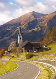 View of the road, Austria. View of the road and St Maria church in Obervellach village, Austria Stock Photos