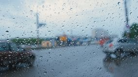 View of the road from the car window through the rain. Blur. Young woman shoots a video on a mobile phone on the Playground stock video