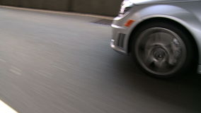 View of the road and cars as they pass camera stock footage