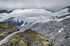 View of a road from Dalsnibba viewpoint view a huge glacier in the background royalty free stock photo
