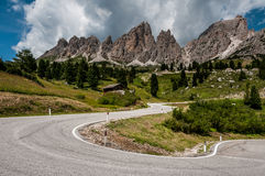 View of the road in the Dolomites near Passo Gardena Royalty Free Stock Photos