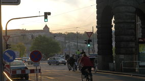 View of road intersection with red traffic light, cars, horse carriage and tram, Prague, Czech Republic stock footage