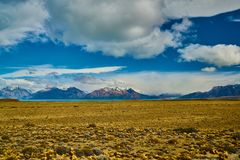 View of the road, Lake Argentino and mountains. Argentine Patagonia in Autumn royalty free stock images