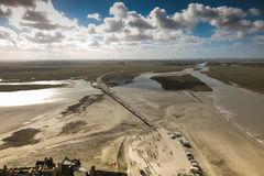 View of the road leading to Mont Saint Michel, France. At low tide Royalty Free Stock Image
