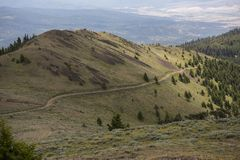 Long road to the to mountaintop, Dixie Butte, Oregon. View of the road leading to the top of Dixie Butte, in Grant County, Oregon, USA Stock Photos