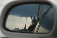 Russian church in the mirror of the car royalty free stock photo