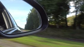 View of the road in the rearview mirror of a car stock video footage