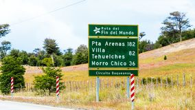 View of the road shield with the distance to the city Pta Arenas 182 km, Villa Tehuelches 82 km, Morro Chico 36 km, Patagonia,. South America stock photo