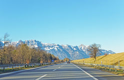 View from road on snow covered Swiss mountains Stock Photography