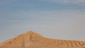 View from the road to the African dunes in the desert near the o Stock Photo