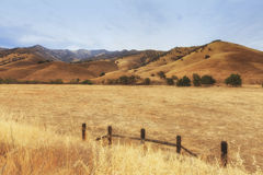 View from the road to Kings Canyon national park, USA. View of the deadgrass fields and mountains on the horizon Stock Photos