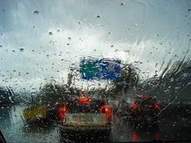 View of road and traffic jams on a rainy day from inside a car with the wet car glass. City, transportation, abstract, background, blur, blurred, blurry, color stock photo