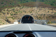 View of road tunnel and the mountain inside the car in sunny day Stock Photography