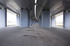 View on the road under concrete road bridge Stock Photo