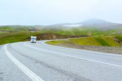 View of the road and van in severe nature of northern Norway way to Nordkapp stock photography