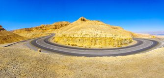 Winding desert road. View of road 25 winding between the desert cliffs, in the northern Arava valley, southern Israel Stock Images