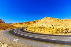 Winding desert road. View of road 25 winding between the desert cliffs, in the northern Arava valley, southern Israel Stock Photo