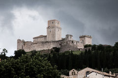 View of Rocca Maggiore of Assisi with background of incoming storm Royalty Free Stock Image