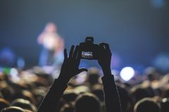 View of rock concert show in big concert hall, with crowd and stage lights, a crowded concert hall with scene lights, rock show pe. Rformance, with people Royalty Free Stock Image