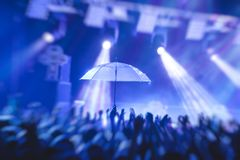 View of rock concert show in big concert hall, with crowd and stage lights, a crowded concert hall with scene lights, rock show pe. Rformance, with people Stock Photos