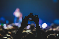 View of rock concert show in big concert hall, with crowd and stage lights, a crowded concert hall with scene lights, rock show pe. Rformance, with people Royalty Free Stock Photography