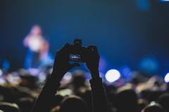 View of rock concert show in big concert hall, with crowd and stage lights, a crowded concert hall with scene lights, rock show pe Royalty Free Stock Photography