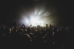 View of rock concert show in big concert hall, with crowd and stage lights, a crowded concert hall with scene lights, rock show pe Stock Photo