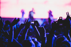 View of rock concert show in big concert hall, with crowd and stage lights, a crowded concert hall with scene lights, rock show pe Stock Photos