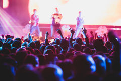 View of rock concert show in big concert hall, with crowd and stage lights, a crowded concert hall with scene lights, rock show pe. Rformance, with people Royalty Free Stock Images