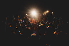 View of rock concert show in big concert hall, with crowd and stage lights, a crowded concert hall with scene lights, rock show pe Royalty Free Stock Image