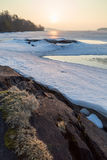 View of rock, frozen lake and cracked ice Royalty Free Stock Image