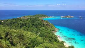 View from Rock Viewpoint on the Beach Filled with Toutists and Blue Water with Speedboats. Similan Island, Thailand. HD. stock video