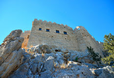 View of a rock wall with walls and a medieval castle Stock Image