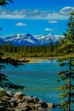 View of the Rockies from the South Saskatchewan River. Aylmer Provincial Recreation Area, Alberta, Canada Stock Photo