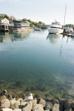 View from the rocks. A view of a restaurant next to a small marina in Maine Royalty Free Stock Photography