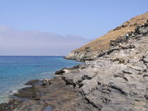 A view from the rocks of the Aegean sea. A summer morning in island Kythnos, at the magnificent beach of Stifo stock images