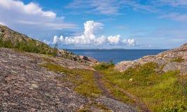 View of rocks of the archipelago of Kuzova,sea, blue sky, clouds Stock Photos