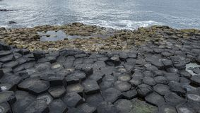 Irelands rocky Giant Causeway. A view of rocks from the Giant Causeway in Northern Ireland stock image
