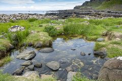 Irelands rocky Giant Causeway. A view of rocks from the Giant Causeway in Northern Ireland stock images