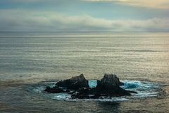View of rocks in the Pacific Ocean, from Crescent Bay Point Park Stock Photography