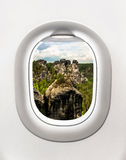 View of rocks in Saxon Switzerland from airplane window Royalty Free Stock Photo