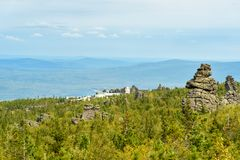 Rocks and Shad Tchup Ling Buddhist monastery on mountain Kachkanar. The Urals. Russia Stock Photography