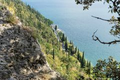 Shore road on Lake Garda. View from the rocks on the shore road on Lake Garda in Italy stock photos