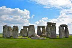 Rocks of Stonehenge On a Cloudy Summer Day. View of the Rocks of Stonehenge On a Cloudy Summer Day, Green grass royalty free stock photo