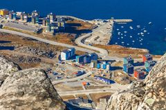 View from the rocks  to the Nuuk city with modern buildings and. Marina at the fjord, Greenland Stock Photo