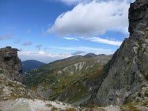 View through the rocks to the ridge of the mountain range in Rila Mountains stock photos